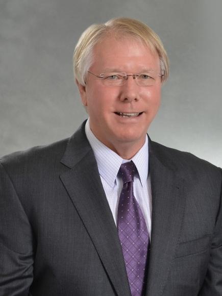 Craig L Adams