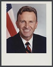 James E Rogan